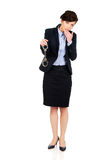 Businesswoman holding metal handcuffs. Royalty Free Stock Image