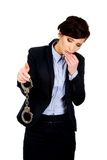 Businesswoman holding metal handcuffs. Royalty Free Stock Photos