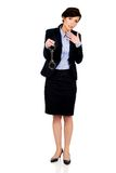 Businesswoman holding metal handcuffs. Royalty Free Stock Images
