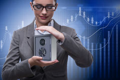 The businesswoman holding metal safe in security concept Stock Image
