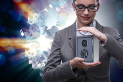 The businesswoman holding metal safe in security concept Royalty Free Stock Photos
