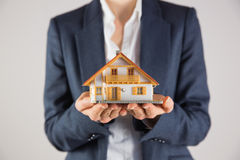 Businesswoman holding miniature model house Royalty Free Stock Image
