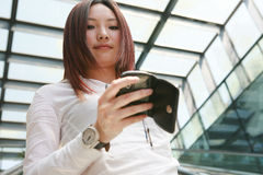 Businesswoman holding mobile phone Royalty Free Stock Image