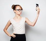 Businesswoman holding mobile phone Stock Photo