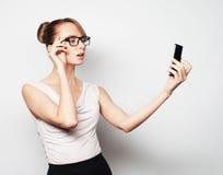 Businesswoman holding mobile phone Stock Photos