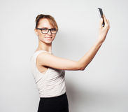 Businesswoman holding mobile phone Royalty Free Stock Photos