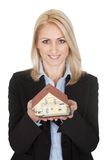 Businesswoman holding model of a house Stock Photo