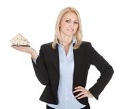 Businesswoman holding model of a house Stock Image