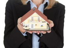 Businesswoman holding model of a house Royalty Free Stock Images