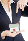 Businesswoman holding a model of house Stock Images