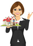 Businesswoman holding a model house Stock Photography