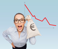 Businesswoman holding money bag with euro Stock Image