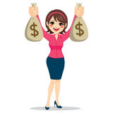 Businesswoman Holding Money Bags. Beautiful businesswoman holding two big dollar money bags happy Stock Images
