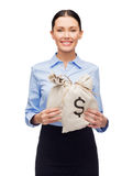 Businesswoman holding money bags with dollar Royalty Free Stock Image