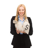 Businesswoman holding money bags with dollars Stock Image