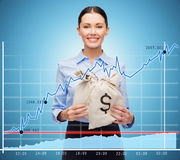 Businesswoman holding money bags with euro. Business, people, finances, investments and banking concept - young businesswoman holding money bags with euro and Royalty Free Stock Images