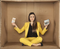 Businesswoman holding money and calculator Royalty Free Stock Photo