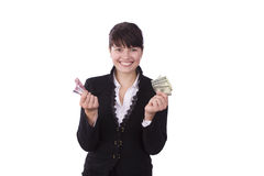 Businesswoman holding a money and smiling. Royalty Free Stock Image