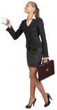 Businesswoman holding mug and briefcase Stock Photos