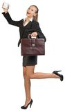 Businesswoman holding mug and briefcase Royalty Free Stock Image