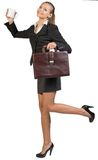 Businesswoman holding mug and briefcase Royalty Free Stock Photos