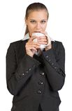 Businesswoman holding mug at her mouth Royalty Free Stock Image