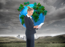Businesswoman holding new tablet Stock Photos