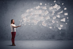 Businesswoman holding newspapers Royalty Free Stock Image