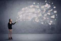 Businesswoman holding newspapers Royalty Free Stock Photo