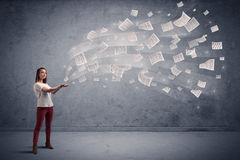 Businesswoman holding newspapers Stock Photography