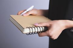 Businesswoman holding notebook royalty free stock images