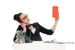 Businesswoman  holding notebook, talking on the phone Royalty Free Stock Photography