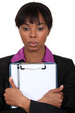 Businesswoman holding a notepad Stock Images