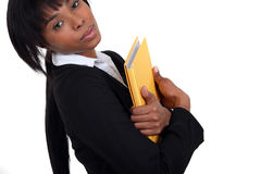 Businesswoman holding a notepad Stock Image