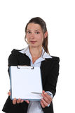 Businesswoman holding a notepad Royalty Free Stock Photos