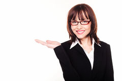 Businesswoman Holding Out Empty Palm Stock Photos