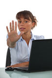 Businesswoman holding out hand Royalty Free Stock Image
