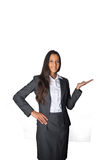 Businesswoman holding out her empty palm Stock Photos