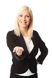 Businesswoman holding out her hand Royalty Free Stock Image