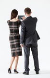 Businesswoman holding a pad and showing her partner something Royalty Free Stock Photography