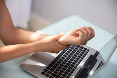 Businesswoman Holding Painful Wrist royalty free stock photo