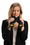 Businesswoman holding a pair of binoculars Royalty Free Stock Photos