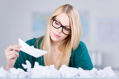 Businesswoman Holding Paper Boat With Paperballs In Front Royalty Free Stock Images