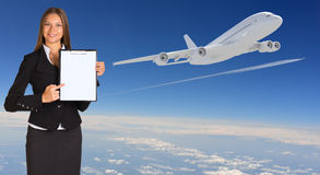 Businesswoman holding paper holder. Airplane in Stock Images