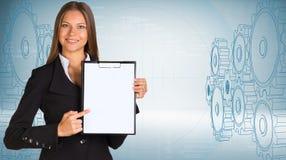 Businesswoman holding paper holder Stock Photo