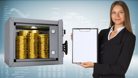 Businesswoman holding paper holder. Safe with gold. Coins. High-tech graphs as backdrop Royalty Free Stock Photos