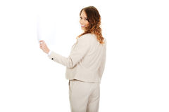 Businesswoman holding a paper sheet. Stock Photo
