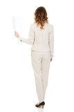 Businesswoman holding a paper sheet. Royalty Free Stock Image