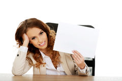 Businesswoman holding a paper sheet. Royalty Free Stock Photos