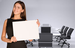 Businesswoman holding paper sheet Stock Photography